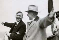 """Governor A. Harry Moore (l) of New Jersey and Governor Al Smith (r) of New York point in the direction of their respective states at the groundbreaking of the """"Fort Lee Bridge"""" which will later be called the George Washington Bridge, in October 1927."""