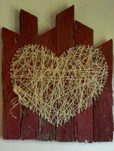 Made out of old demolished barn wood, twine, and nails. Love this! Thinking it would be cute done with the first letter of our last name!