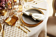 Go for the gold (and glam) with a patterned runner and gilded silverware: A neutral-hued tablecloth in gray or taupe will keep the table toned down.  Love the white animals
