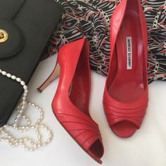 """HP Red hot Manolo Blahnik peep toe pumps Tons of class with a hint of sass! Gorgeous red leather stilettos. Peep toe with pleated vamp. Covered 3.75"""" heel. Authentic, of course--handmade in Italy. ‼️Marked EU size 39, but Manolos run a half size small. I'm a solid US size 8.5, and these fit me perfectly.‼️ Gently loved, but in BEAUTIFUL condition. Wear on soles, of course. Manolo Blahnik Shoes Heels"""