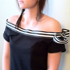 Easy reconstruction...get a soft cotton tee and make neckline bigger and add ribbon.