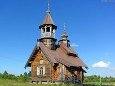 Classic slant room wooden church of St. Basil the Great was built in year of 2000 by St. Petersburg artist Gretsky in Akulova mountain village.