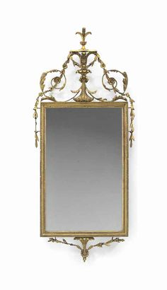 A GEORGE III GILTWOOD AND GILT-COMPOSITION MIRROR
