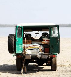 Jeep Rigged with Camping Supplies and Hudson Bay Point Blankets