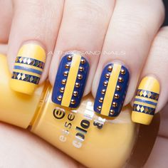Hand placed glitter and studs on yellow & blue nail art design (Instagram photo by  athousandnails)