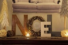"""NOEL ~ Christmas Mantle Inspiration! DIY  This is a GREAT display! 3 Paper Mache Letters, 2 large, 1 small, and a grapevine wreath for the """"O""""! Some paint and glitter and you have a wonderful holiday display! Michael's carries the cardboard letters and you can use your 40% off online coupon they feature each week! DIY Link HERE: http://www.teresamariephotos.com/im-on-a-roll-another-diy/#"""