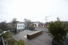 The pièce de résistance of the house is its roof terrace, accessed by climbing a slim set of steps and stepping through a hatch created by a retractable glass roof.