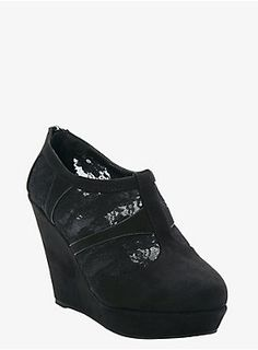 """With a sexy platform wedge and a closed toe, these black faux suede shoes feature black lace insets on the sides that reveal just a touch of skin. Back zip entry.<ul><li> 4 1/4"""" wedge with 1 1/4"""" platform</li><li>Man-made materials</li><li>Imported</li></ul>"""