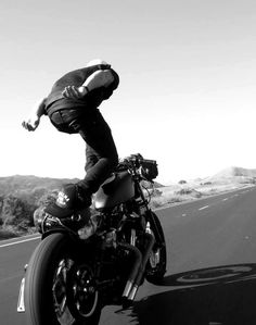 stand on the seat of a moving motorcycle