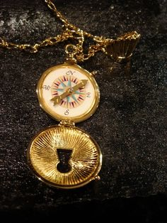 Pocahontas necklace -- John Smith's compass. I want this necklace and want it as a tattoo