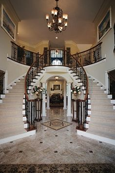 Toll Brothers Two-story foyer with curved staircases
