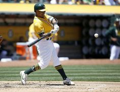 Oakland Athletics' Khris Davis (2) hits a double against the Washington Nationals during the second inning of a baseball game on Sunday, June 4, 2017, in Oakland, Calif. (AP Photo/Tony Avelar) Photo: Tony Avelar, Associated Press