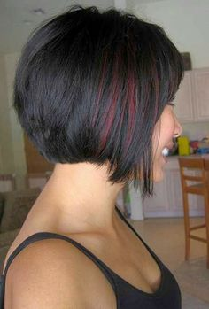 See more Pretty bob haircut, straight across back and longer piece surrounding the face and chin. Blacky-auburn colour with auburn streak.