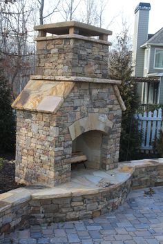 Outdoor Stacked Stone Fireplace with Hearth and Seating Wall Outdoor Wood Burning Fireplace, Outdoor Stone Fireplaces, Outdoor Fireplace Designs, Backyard Fireplace, Diy Fireplace, Fireplace Seating, Backyard Layout, Backyard Pool Landscaping, Backyard Pool Designs
