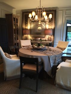 Dimmers are a dining must!  The added lamplight on the sideboard helps increase the light level in the room, but keeps it soft and pleasant.