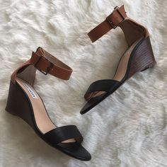 Nanncy Ankle Strap Wedges Extremely popular low wedge flats. Ankle strap is functional but the back zip behind the ankle is more practical for easy on/off. Since these are black and brown they go with EVERYTHING! Steve Madden Shoes Flats & Loafers