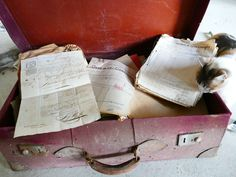 We cleaned out the Château pigeonnier (pigeon house) this summer and found this suitcase, filled with old photographs of the family, receipts, letters, and even an old invoice for work done at the local train station.