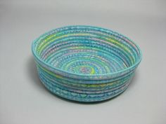 Fabric Coiled Bowl, Handmade Multi-Colored Basket, Hand Coiled Fabric Bowl or Basket, by MainelyStitches on Etsy https://www.etsy.com/listing/253909544/fabric-coiled-bowl-handmade-multi