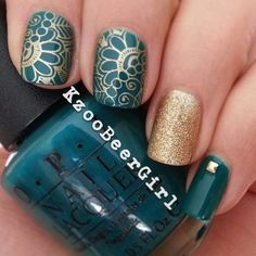 A noble combination of dark turquoise and golden colors belongs to classical color patters. Such a tandem will suit well for self-confident and restrained ladies, which prefer stability in their life. The design is performed with nail polishes: base coat is of aquamarine hue, the decoration is gold of different shades and texture. The fantasy floral nail art is stamped with golden nail polish using special stamping plates for decor. Tiny golden studs draw the finishing touch to the image.