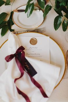 Wedding reception tableware idea - White gold trim plate setting with red satin ribbon.