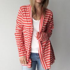 J.Crew lightweight striped Spring cardigan J.Crew lightweight striped cardigan  Preowned- excellent condition. Made of 60% cotton/ 40% polyester. Size Large. Measurements: underarm to underarm is approximately 17 1/2 inches flat across. Back of neck to the bottom of hem is approximately inches. J. Crew Sweaters Cardigans