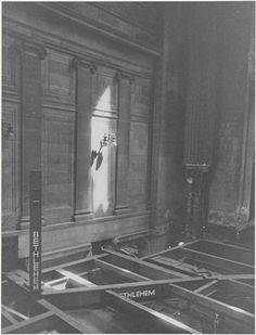 "untitled [The demolition of Pennsylvania Station, 1964-1965]. Girders, one with ""BETHLEHEM"" on it and an intact marble wall with light fixture in background of Penn Station during demolition."