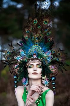 peacock headdress. If I was royalty, I would wear this and never take it off!