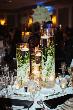 Romantic Florida Destination Wedding. Centerpieces with Floating Candles and White Florals. #whiteflowers #weddingflowers #weddingdecor #weddingday #destinationwedding