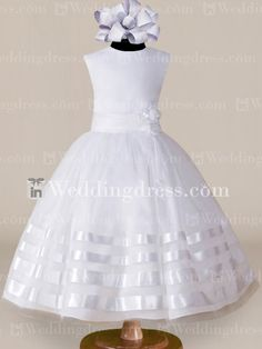 A sleeveless organza dress with a full, gathered skirt accented with four bands of satin ribbon in graduated widths.