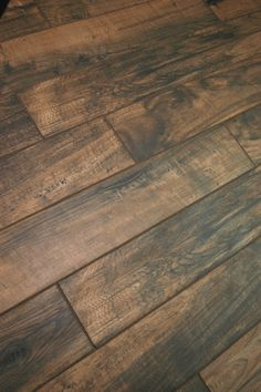 Sherwood 15x90cm wood-effect glazed porcelain floor tile. Suitable for living areas and looks great in bathrooms.