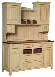 """Sadies Hutch With Baskets is handmade by the Amish.  Your piece will be built with Premium Grade Eastern White Pine wood.  You will see some deformities and knots that come naturally with eastern pine.   Measures: 60"""" W x 82"""" H x 21"""" D Shown in Sand-Thru Buttermilk paint W/ Burnt Umber Stained Top & Baskets Please Note: Baskets included are Amish handmade."""