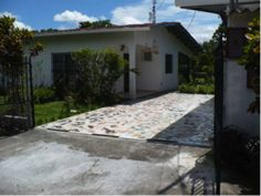 David, Panama home, with driveway in front – Panamanian style homes are built according to accepted standards of the local folks.  Sometimes these properties have been upgraded to include features commonly expected by North Americans. - See more at: http://bestplacesintheworldtoretire.com/questions-and-answers/616-what-s-the-cost-to-rent-a-home-in-boquete-panama#sthash.h7XWNm0M.dpuf