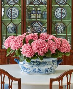 KD - That green background in the cabinet really makes the china pop!