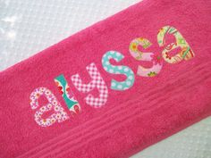 Personalized  Towel -  appliqued name -  Choose Fabric and Towel Color -  Great for beach, bath, pool, rest mat, birthday, Graduation. $18.00, via Etsy.