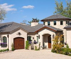 Mediterranean Style - low-pitched red tile roof, arches, grillwork, and a stucco or adobe exterior.