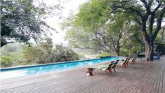 The lap pool is on the banks of a seasonal river, making for great game viewing. Sand Game, Somerset West, Game Lodge, Tropical Architecture, Beach Road, Thatched Roof, Game Reserve, Architect Design, Dark Colors