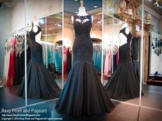 You will look so classy and stylish in this stunning black mermaid. Lace embellishments cover its formfitting bodice and high neckline and the low open back exudes glamour. Fabulous and it's at Rsvp Prom and Pageant, your source for the hottest 2016 Prom Dresses!