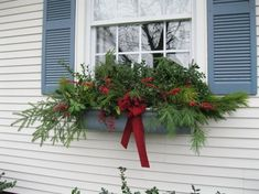 40 Wonderful Christmas Window Decor Ideas - You will find there are many different window stickers you can buy. Each of these will provide you with a way of decorating your home, car or even pla. Winter Window Boxes, Christmas Window Boxes, Christmas Planters, Christmas Window Decorations, Christmas Swags, Christmas Holidays, Happy Holidays, Window Box Flowers, Decor Ideas