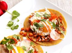 sweet potato tacos flavored with sage and topped with sliced radish, cilantro, crema, and a fried egg. Great for breakfast, but really good any time of day.