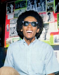 """""""Get Bob Marley's Style - Reggae Fashion: Style: GQ""""  cute in button up short sleeve and black shades."""