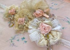 Shabby chic Edwardian style ribbon and lace rosebud rosettes appliques. £35.00, via Etsy.