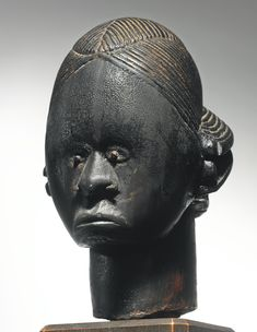 FANG-BETSI RELIQUARY HEAD, GABON Height: 9 1/8 in (23.2 cm) Sotheby's New york In Pursuit of Beauty: The Myron Kunin Collection of African Art 11 November 2014