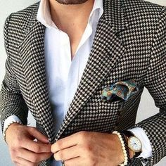 This combination of a houndstooth blazer and a white dress shirt oozes masculinity and refined elegance.
