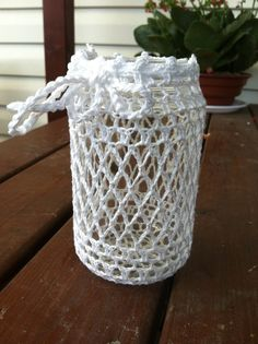¥¥¥ een glazen potje omhaken en een waxine lichte er in geeft een mooie sfeer