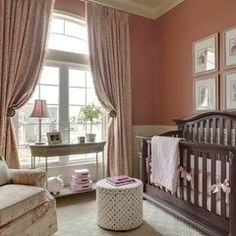 Dark wood crib in pink and white nursery