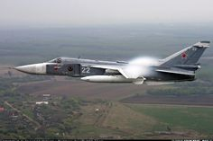 Towing Su-24M after airshow. - Photo taken at Voronezh - Baltimor  (UUOW) in Russia on July 9, 2005.