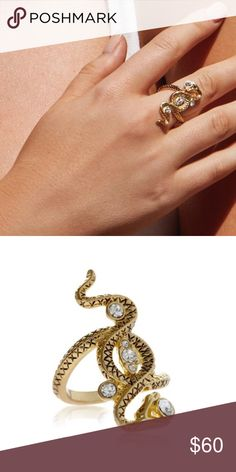 """Luv AJ Gold Twisted Serpent Statement Ring COMPLETELY SOLD OUT ONLINE! Killer statement ring by LUV AJ. Yellow gold with CZ stones. Etched """"snake"""" detail. Gold-plated brass. MSRP: $70 + tax.  BRAND NEW WITH TAGS: Re-poshing because it's too big for me and I'm worried it will fall off if I risk it. In that sense, this piece fits true to size (I'm usually a size 5.5 or size 6). Original tags attached. Gift box included.  Smoke and pet-free home! I often adjust my pricing during Posh parties…"""