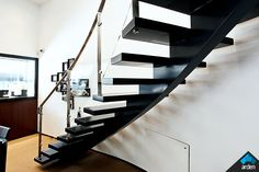 This contemporary, modern-styled stair is designed to make an specific design statement in the broader architectural design