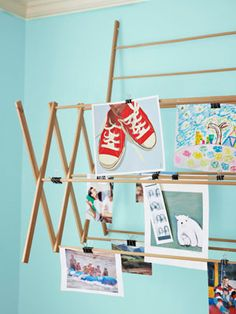 Exhibit the latest works from your little one with an interactive and casual display made of a clothes-drying rack attached to the wall. #decorating