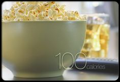 6 Cups Microwave Popcorn: When you want a large snack with a small calorie count, popcorn delivers. Some microwave brands have just 100 calories in 6 cups. You have to chew it, so its satisfying, says Joan Salge Blake, RD, a spokesperson for the American Dietetic Association. Its also high in fiber, which can help you stay full longer. 				 Saturated Fat: 0.5 g Sodium: 220 mg Cholesterol: 0 mg Carbs: 24 g